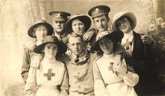 British Red Cross nurses pose for a group photo with soldiers, United Kingdom, ca. 1915