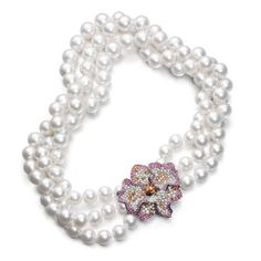 Tiffany three strand pearl necklace with white sapphire and diamond orchid clasp.
