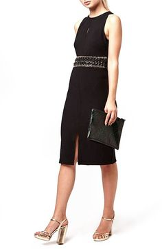 Wrapped around the waist with a crystal-trimmed, woven faux-leather embellishment and fronted with skin-peeking slits, this stunning knee-length dress is the sophisticated piece you need for that upcoming work party.@nordstrom