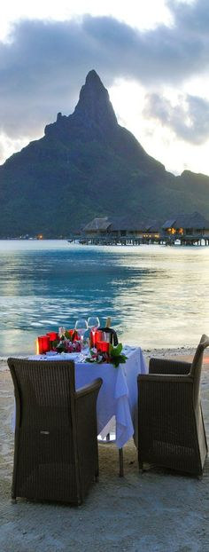 Have a romantic dinner with my husband on the island of Bora Bora