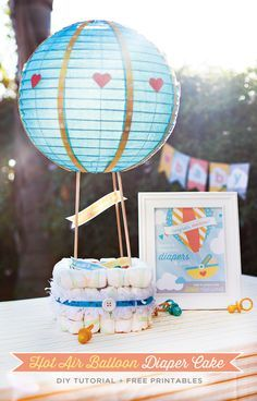 To have on tables with things in basket!!  Hot Air Balloon Diaper Cake Tutorial + Free Printables!