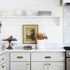 beige cabinets and white countertops in the kitchen