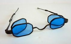 """D Frame spectacles.  Octagonal sliding 4 lens blue glass spectacles signed Schildknecht. They measure across the front, inside 4"""" with the side lenses open, closed 4 1/2"""" across. sides fully extended to 6 1/4."""" Circa 1850s, 19th century."""