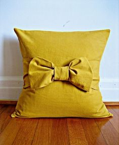 Mustard Bow Pillow Cover. $54.00, via Etsy.