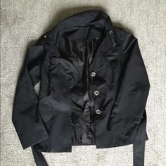 White House Black Market Light Jacket This feminine looking jacket fits someone who is around a size 12. The ruffle on the front is my favorite part. It has a tie to sinch up the waist for a very flattering look! Reaches down around the hip area. Cut the tags out for comfort but it is from White House Black Market. White House Black Market Jackets & Coats Pea Coats