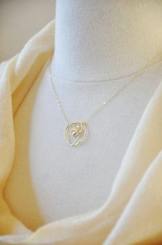 Gold wire rose necklace, nature inspired, flower, abstract, unique design, 14K gold filled chain, everyday necklace, dainty feminine, casual  16K gold plated wire is twisted to form a rose shaped pendant. It is then suspended on a delicate 14K gold filled chain and finished with a 14K gold filled spring clasp.  Dimension  Pendant : ~0.75 inch x 0.75 inch Chain length: 17 inches  The necklace will be packaged in a white jewelry box, sealed with a YSM Designs logo and ribbon, ready to be given…