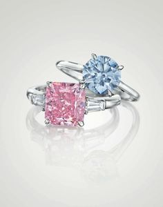 A round brilliant- cut fancy intense blue Type IIb diamond ring of 1.74 carats. A cut–cornered rectangular fancy vivid purplish pink diamond ring of 3.74 carats.