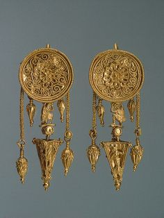 Pair of Earrings with a Disc and a Pyramid, 330-300s BCE The Hermitage Museum