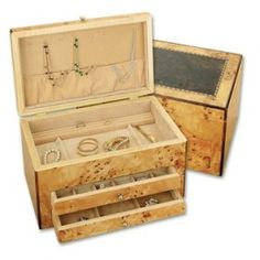 Gorgeous Handcrafted Jewelry Chest • Exterior features inlaid design surrounded by Bird's Eye Maple, polished to a high gloss finish •