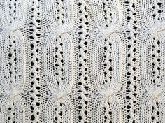 An intricate combination of eyelets and cable. We recommend thin needles and mercerized cotton for this twisted lace knitting pattern. Twisted lace makes...