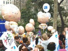Baby foil balloons and printed balloons used on an RCM march.
