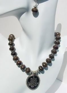 ELEGANT BRONZITE NECKLACE SET This stunning handmade Bronzite necklace is designed with 16mm Bronzite faceted Rondells and sterling beads.  A Tibetan Agate Silver Pendant add a nice flair of elegance to the necklace, which is completed with Sterling Silver clasp. Necklace Set, Agate, Beaded Jewelry, Jewelry Making, Sterling Silver, Beads, Stone, Elegant, Nice