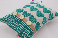 A scrumptious little pin cushion by Caroline from Beautiful Thinking at Etsy.