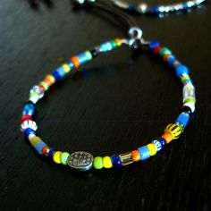 CATHERINE MICHIELS(キャサリンミッシェル)/Single side/oxidized SS mini oval w/diamond on African Beads/アパレルセレクトショップ -トリーザンオンライン