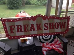 """I finally decided to make an account after lurking here for 4 or so years. Yay! I made my general FREAKSHOW sign out of 3/4"""" insulation foam & added LED globe lights. It wasn't easy, but is anything ever? I measured & cut the back piece first, then eyeballed approx 2 inches on the edges for the frame. I measured the holes for the lights on the back piece first & drilled those holes, then turned it over & sharpied where the holes would fall"""