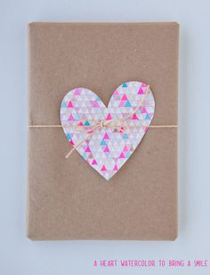 Just a simple cutout and it brightens up the dull packaging instantly! Great for days when I've got zero gift wrapping ideas :)