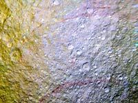 Like graffiti sprayed by an unknown artist, NASA's Cassini spacecraft has spotted unexplained arc-shaped, reddish streaks on the surface of Saturn's icy moon Tethys. The red arcs are narrow, curved lines on the moon's surface, and are among the most unusual colour features on Saturn's moons to be revealed by Cassini's cameras, the US space agency said in a statement. See more : http://post.jagran.com/nasa-probe-spots-unusual-red-arcs-on-icy-saturn-moon-1438237562