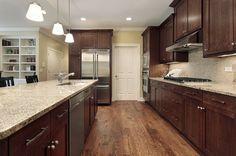 Brown kitchen with wood floors, kitchen design, kitchen ideas, kitchen inspiration!