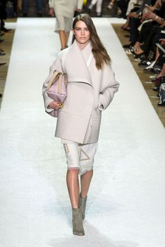Chloe. Fall 2014. Oversized wrap jacket-coat in soft subdued pink, white knee length dress patterned with golden geometric figures, grey ankle boots, soft pink handbag.