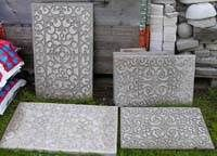 Rubberized door mats pressed in concrete forms and left to dry for 2 days.  AWESOME stepping stone ideas!