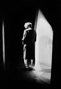 Édith Piaf before a performance the Olympia music hall. She always hesitated a little and remained for a short while next to the stage curtain, made a few steps forward to get up her courage, and then...