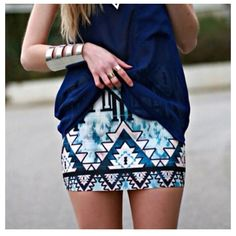 loose navy blue top and blue/white tribal print skirt
