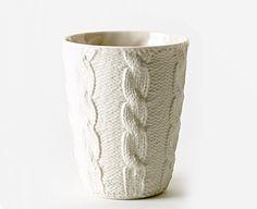 ceramic. Texture of fabric imprinted into clay mug.