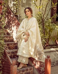 Embellished organza shirt front and back Embroidered badla/karandi dupatta Embellished korean raw silk pants  Clad in a white intricately embroidered full length kameez and a dupatta glistening in the afternoon sun, she gazes away upon the walls of her courtyard filled with her childhood memories. Away from the excitement of her cousins, who have been dancing to the cheerful tunes tirelessly, she takes a moment to stop.  Three piece fully embroidered and embellished outfit. Desi Wedding Dresses, Pakistani Formal Dresses, Pakistani Dress Design, Indian Wedding Outfits, Pakistani Outfits, Indian Outfits, Nikkah Dress, Eid Dresses, Ethnic Outfits