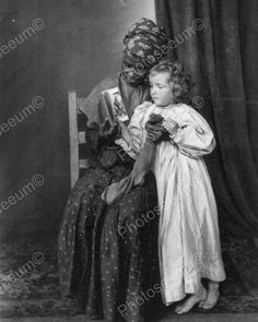 Child with Black Nanny Christmas Vintage 8x10 Reprint Of Photo Child with Black Nanny Christmas Vintage 8x10 Reprint Of Photo Here is a neat collectible featuring a tender moment between a small child and her black nanny on Christmas day in a vintage 8x10 Reprint Of photo. Reproduced photo is in mint condition. This photo will be shipped protected in a padded mailer. Please note the Photoseeum fine print in the foreground of all the photos will not be in the printed version you purchase. All…