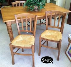Farm house style table in a rich sturdy knotty pine. Accent with whimsical rush, wicker seats.      Yesterdays Treasures Consignment    1185 Second Street Suite H    Brentwood    925 - 516 - 8549