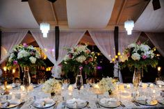 Elegant display of flower centerpieces and classic table settings
