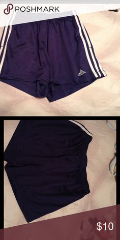 Adidas blue shorts Adidas navy blue shorts. Good used condition. Drawstring tie on inside waist. Elastic waistband. Size Medium. Measures 13 inches from waist to hem. Adidas Shorts