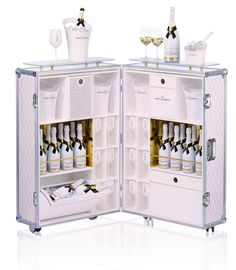 Champagne house Moët & Chandon has released the Summer Escape Trunk; the epitome of sheer luxury and the perfect solution to having an unforgettable summer. Moet Chandon, Champagne Moet, Moet Imperial, Don Perignon, Cheers, Luxury Bar, Mobile Bar, In Vino Veritas, Glass Shelves