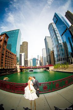 Kissing newlyweds on bridge over river in downtown Chicago #Michiganwedding #Chicagowedding #MikeStaffProductions #wedding #reception #weddingphotography #weddingdj #weddingvideography #wedding #photos #wedding #pictures #ideas #planning #DJ #photography #bride #groom