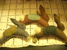 You will need: Poster board or lightweight cardboard Freezer or Butcher Paper Scraps of felted wool Two buttons Embroidery floss Small amou...