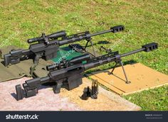 Two Sniper Rifles .50 Bmg Caliber On Shooting Range. With .50 Bmg ...