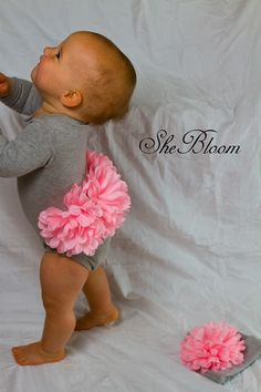 This is too cute! fake flowers stitched to a onsie bum...could do this on diaper covers...what a great prop for newborn sessions, or on a crawler, or under a cute sundress!