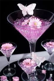 purple martini glass centrepiece with flowers and butterflies...cute!