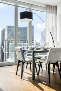 A dream dining room scene at Summit NYC. The Vik chair and Dimensions floor lamp add distinct detail to a simple skyline setting. Photo: Summit NYC. Interior Design by Ligne Roset NYC. #ligneroset #furniture #frenchdesign #design #furnituredesign #interiordesign #interiors #modern #interiorinspiration #diningroom #apartment #diningroomdesign #apartmentinspiration