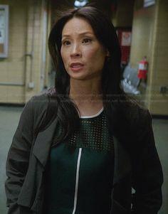 Joan's green perforated dress with white trim on Elementary. Outfit Details: http://wornontv.net/28678/ #Elementary
