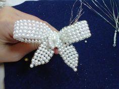 Fotos tomadas por Esther Pérez de Herrera (no reproducirlas) Vista del detalle de un lazo en perlas, para...