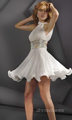 White short dress with silver sash and flowed bottom. Strap around neck.