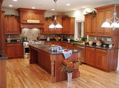 kitchen remodels budget gallery kitchen  retro style country french kitchen remodeling ideas on cheap budget featuring cherry wood l shaped kitchen cabinet with freestanding rectangular islands on natural hickory hardwood floors 1120x838