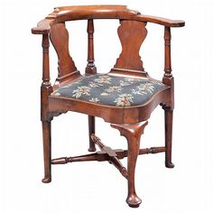 Queen Anne Walnut Corner Chair   Massachusetts, circa 1775   The backscrolled crest continuing to arms with rounded ends, above two splats and three turned stiles, over a slip seat, raised on cabriole legs ending in pad feet.     Doyle Auctioneerss & Appraisers New York