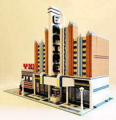 LEGO Art Deco Galaxy Diner and Empire Theater ~One would think that Streamline, of all things, would be nigh impossible to do with blocky LEGO pieces… but the LEGO builders are a resourceful lot. Lego Boards, Lego Builder, Lego Modular, Cool Lego Creations, Lego Projects, Custom Lego, Lego Moc, Lego Pieces, Lego City
