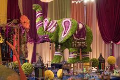 Traditional Indian Wedding Decor With An Alluring Floral Elephant Centerpiece And Table Smaller Flower Arrangements Lanterns