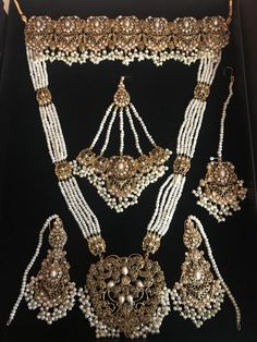gold plated bridal set in American diamonds and fresh water pearls. Set includes: choker, long necklace, earrings, tikka and jhoomar. Nose ring can be add Indian Jewelry Earrings, Indian Jewelry Sets, Fancy Jewellery, Head Jewelry, Bridal Jewellery, Jewlery, Hyderabadi Jewelry, Pakistani Bridal Jewelry, Wedding Jewelry Sets