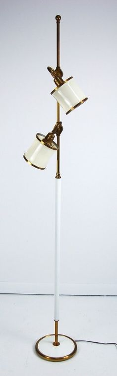 MCM Floor Lamp w/ Swivel Heads $695 - Niles http://furnishly.com/catalog/product/view/id/3268/s/mcm-floor-lamp-w-swivel-heads/