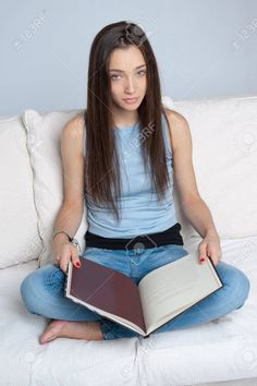 https://previews.123rf.com/images/franckito/franckito1210/franckito121000495/15895819-Portrait-of-a-young-woman-reading-cross-legged-on-a-white-sofa-Stock-Photo.jpg