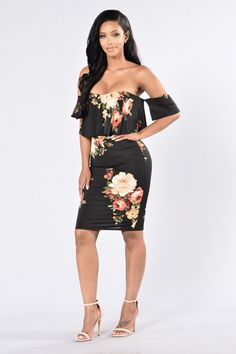 - Available in Black and Mauve - Off Shoulder Dress - Floral Print - Fitted - Ruffle Top - Lined - Made in USA - 96% Polyester 4% Spandex